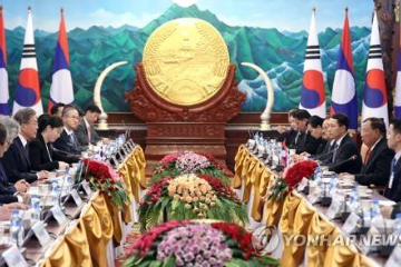 """韩国总统首次对老挝国事访问 希望把""""汉江奇迹""""移植为""""湄公河奇迹"""""""