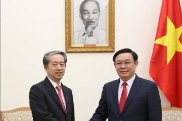 越南政府副总理王廷惠会见中国驻越大使熊波